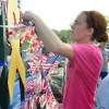 Freshman Libby Frye helps add decorations to the float. Photo by Abby Hans