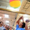 The senior section keeps a giant beach ball aloft in a competition between the four grade levels. Photo by James Wooldridge