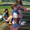 Freshman Annie Jones gets tangled up in multiple strands of American flags. Photo by Morgan Browning