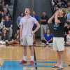 """Seniors Peter Moriarty, Jackson Barnes, Jeff Larrabee and Clark Doerr lead students in the """"I Believe"""" chant to get them pumped for football season. Photo by Callie McPhail"""