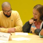 David Muhammad and junior Tyler Keys discuss their table topic with students. Photo by Audrey Kesler