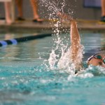Sophomore Grace Apodaca takes a breath during her backstroke lap. Photo by Diana Percy