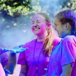 Juniors Maura Kate Mitchelson and Bria Foley throw color powder into the air. Photo by Maddie Smiley