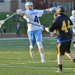 Junior Tripp Mohr passes the ball to his opponent during the first half of the game. Photo by Abby Blake