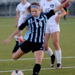 Junior Josie Clough winds up to score the first goal of the game. Photo by Ellie Thoma