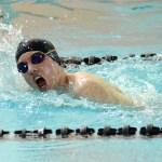 Sophomore Harrison Gloe swims the 500 freestyle. Photo by Luke Hoffman