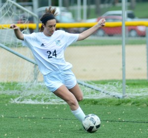 Sophomore Kate Hembree makes a pass to her teammate down the field, trying to score. Photo by Luke Hoffman