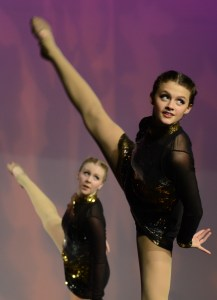 Looking into the audience, sophomore Sam Shrout performs a side tilt. Photo by Grace Goldman