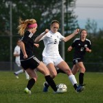 Senior Lily Flint battles her opponent in hopes of getting possession of the ball. Photo by Katherine Odell