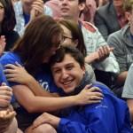Seniors Kylie Ledford and Jacob Desett hug after Ledfords nomination is announced. Photo by Katherine McGinness