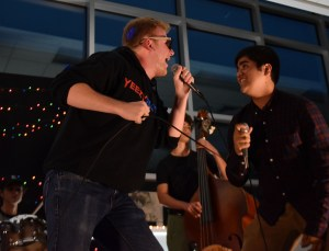 Senior Deegan Pores and junior Siddartha Choudhurry lean closer to each other while on stage to sing the chorus of their song louder. Photo by Lucy Morantz