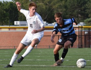 Sophomore Conor O'Toole and freshman Justin Keller fight for the ball. Photo by Audrey Kesler