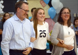 Senior Ally Huffman walks with her family as she is recognized at senior night. Photo by Kate Nioxn