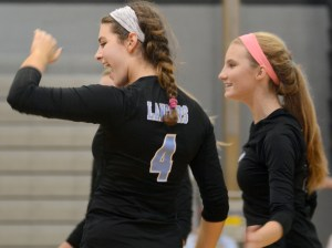 Sophomores Brigid Wentz and Katie Aliber celebrate after they score. Photo by Kate Nixon