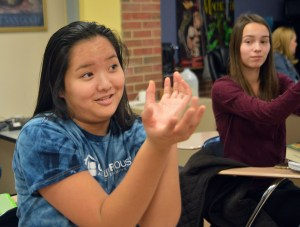 Junior Ella Stotts attempts the wrist movement. It involves twisting your hands around each other. Photo by Ally Griffith