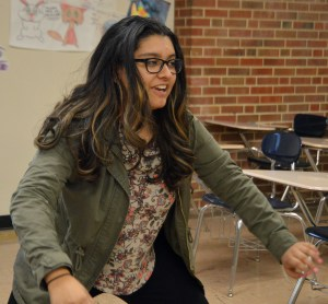 Junior Aakriti Chaturvedi demonstrates a popular Bollywood dance move by equating with her feet pointed outwards. Photo by Ally Griffith