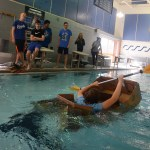 Senior Christian Buller sinks as he tries to cross the pool and his classmates watch. Photo by Ty Browning