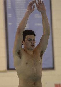 Senior Thomas Sweat prepares to dive off the board. Photo by Kathleen Deedy