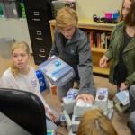 Sophomores Jane Sonnichsen, Sean Paddack, Ellie Falkner, and Anna Gunderman work on third hour's shelter. Photo by Kathleen Deedy