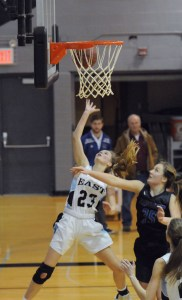Sophomore Camryn Gossick goes up for a lay up. Photo by Izzy Zanone