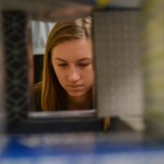 Sophomore Eva Hill carefully adds tissue boxes to the fort. Photo by Kathleen Deedy
