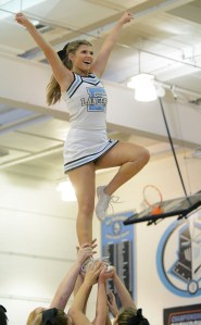 Junior Maggie Gray cheers during a time out. Photo by Katherine McGinness
