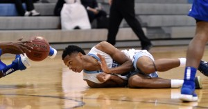 Senior Kelyn Bolton lays out on the floor to get the ball in the last minute of the game. Photo by Lucy Morantz