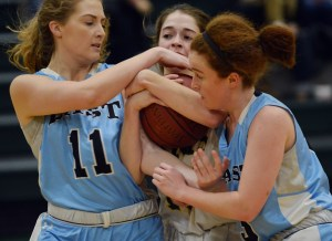 Junior Emma Eberhart and senior Libby Frye fight for the ball. Photo by Ally Griffith
