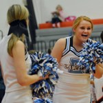 Senior Chloe Krause laughs as she cheers at the beginning of the game. Photo by Ally Griffith