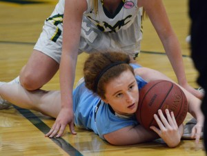 Senior Libby Frye lies on the floor after recovering the ball. Photo by Ally Griffith
