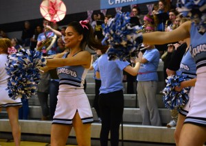 Senior Astrid Cifuentes dances during a cheer routine to one of the band's songs. Photo by Aislinn Menke