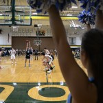 Senior Will Curran takes the free throw with a cheerleader watching. Photo by Ty Browning