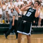 Senior Will Curran nervously watches the ball waiting to see if his free throw shot went in. Photo by Lucy Morantz