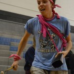 Freshman Zeke Krause bangs his cowbell while the band plays to hype up the crowd. Photo by Kathleen Deedy