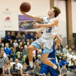 Sophomore Nick Arensberg makes a dunk. Photo by Luke Hoffman