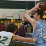 Sophomore Joseph McGrath looks for an open teammate to pass to. Photo by Ellen Swanson