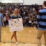 """Senior Anna McClelland asks senior Brian Christian to WPA as the crowd finishes the """"do it"""" chant. Photo by Grace Goldman"""
