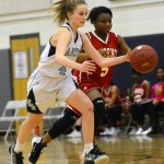 Freshman Paige Peugot  runs down the court with possession of the ball. Photo by Hadley Hyatt