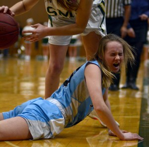 Sophomore Camryn Gossick falls to the floor after attempting to regain possession. Photo by Kate Nixon