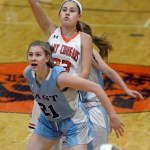 As she guards a player, senior Sofia Stechschulte watches as a shot goes in the basket. Photo by Kate Nixon
