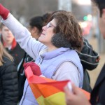 A woman who joined the counter-protest early on chants at the Wesboro Baptist members. Photo by Luke Hoffman
