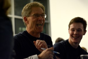 Chemistry teacher Steven Appier laughs at his team's answer to a question. Photo by Luke Hoffman