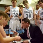 During a timeout, with the Lancers trailing the Hawklets, coach Shawn Hair talks to his players.  Photo by Luke Hoffman
