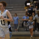 Senior Libby Frye runs down the court as her team dribbles the ball down to try to score a shot. Photo by Morgan Plunkett