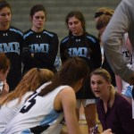 Coach Lawrence talks to the team during half time, we were down and score was 25-15. Photo by Morgan Plunkett