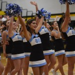 All of the varsity Cheerleading squad cheers and waves after they finish with their routine. Photo by Morgan Plunkett