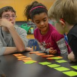 Two students play a review game, applying what they learned. Photo by Kathleen Deedy
