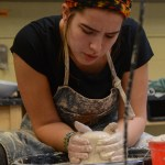 Sophomore Willa Ivancic shapes cylinder of clay. Photo by Kathleen Deedy.