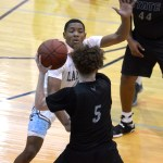 Senior Deonte Carroll tries to get the ball from an opposing player. Photo by Luke Hoffman