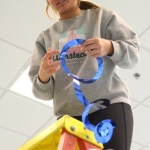 Sophomore Elise Griffith begins to hang up ceiling decorations. Photo by Luke Hoffman
